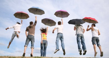 jumping group with umbrellas